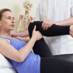 woman going to physical therapy to relieve knee and hip pain